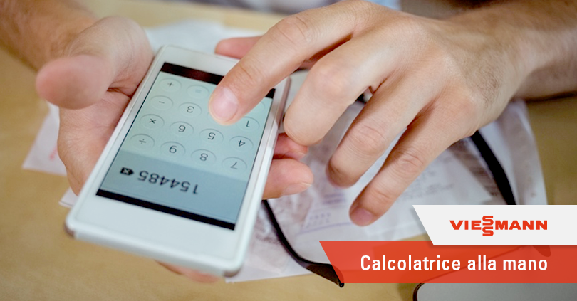 Mid section of man calculating bills on mobile phone